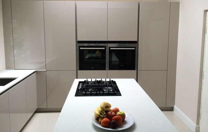 Nice Make retrieving your pots and pans easy with the Schuller Le Mans system Fino Sand Grey High Gloss Kitchen Cupboards Keuken idee Pinterest Gloss