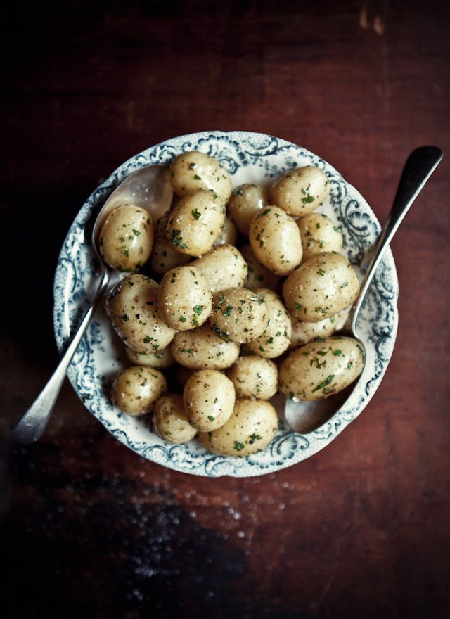 Minted potatoes with Lemon oil and Sea Salt: 1 kg baby potatoes  Handful fresh mint leaves, very finely chopped  30 g unsalted organic butter, melted*  Good pinch sea salt flakes, crushed  Freshly ground black pepper  Lemon infused olive oil