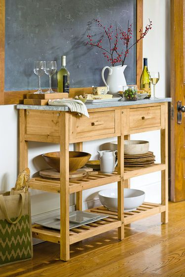 Farmhouse Potting Bench from Gardener's Supply. Not exactly what I want but closer than most of what I've seen.