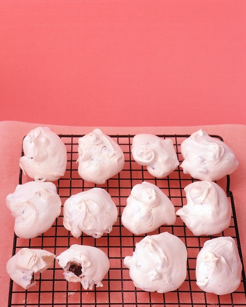 Chocolate Chip Meringues:  I make a variation of this recipe...turn off the oven when you out the meringues in, and leave overnight...keeps the meringues white.
