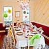 Hanging decorations brighten up the whole room!  One of our favorite baby shower ideas includes using the Fisher Price jungle pattern as a palette, and adding sunny-colored decorations overhead so guests will look up in wonder. Drape fluffy garlands of paper flowers over the chandelier. A plain wall can be transformed with crepe streamers taped up in a criss-cross pattern to create a two-tone basket-weave effect.