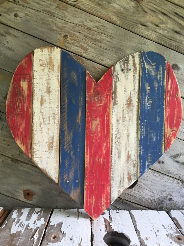 Show off your patriotic side with this beautiful reclaimed red white and blue pallet heart! This large heart, measures approximately 2 ft by 2 ft. Created from reclaimed wood, it's perfect for hanging                                                                                                                                                                                 More
