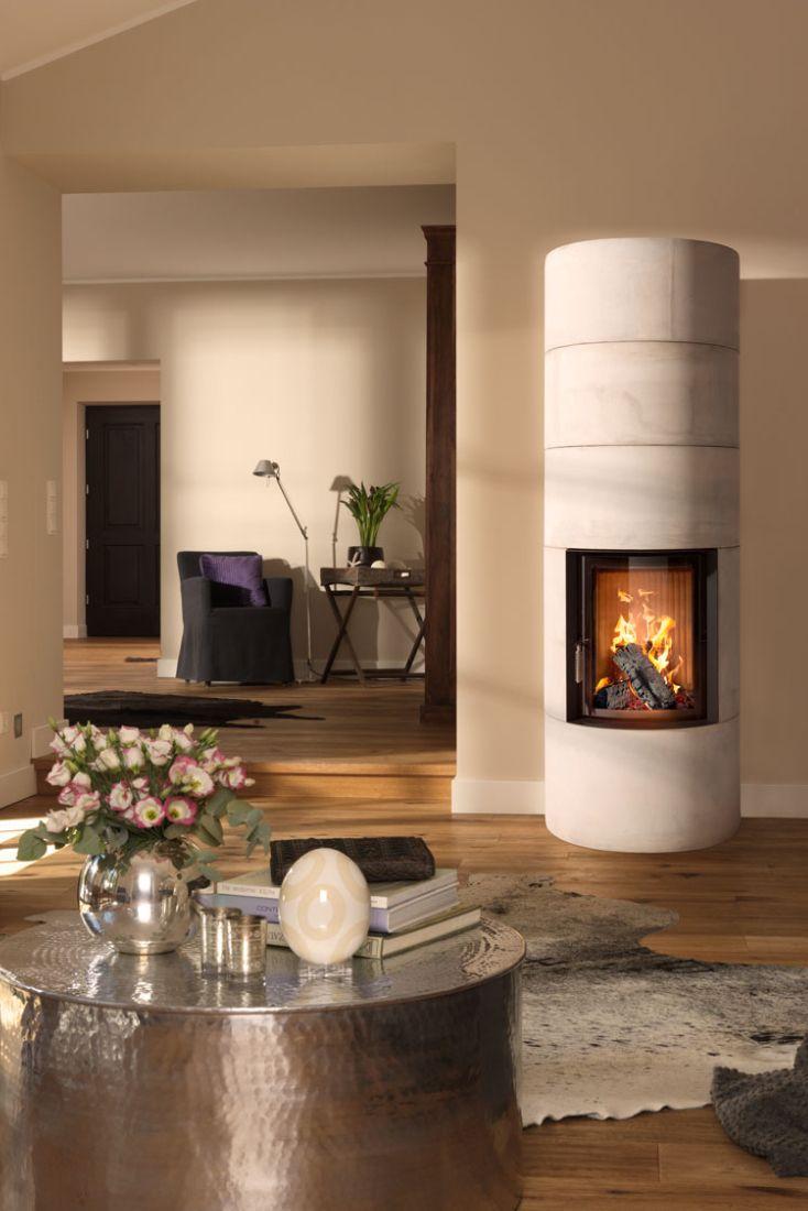 angenehme strahlungswarme fur jeden wohnraum mit einem runden systemofen im beton gewand so geht einrichtung heute und die kalten tage sind gezahlt