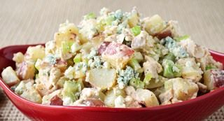 Buffalo Chicken Potato Salad: This super side marries creamy potato salad with the mild heat of Buffalo wings - complete with the trimmings - celery and blue cheese. andlt