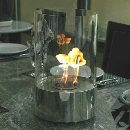 Accenda Freestanding Fireplace. With a reservoir of 4 litres of ethanol, the clean burning flame can brighten up any dinner, while allowing itself to be transported easily into another room thereafter. The tempered glass enclosure won't shatter from the heat. It weighs 17lbs and measures a very reasonable 9 x 10 x 15 inches.    Tabletop fireplace fun can be yours for $129.