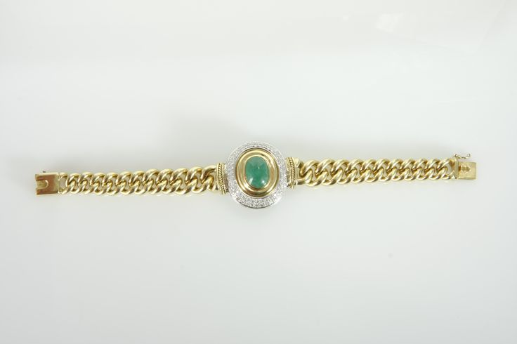 A DIAMOND AND EMERALD BRACELET, JENNA CLIFFORD   the 18ct gold curb-link chain, centred with a cabochon-cut emerald weighing approximately 7,50cts, surrounded by two rows of pave set round-brilliant cut diamonds (78 diamonds) weighing approximately 1,70cts in total, in 18ct yellow and white gold, length approximately 190mm. gold weight - bracelet: 68.2g centrepiece - 31.99g