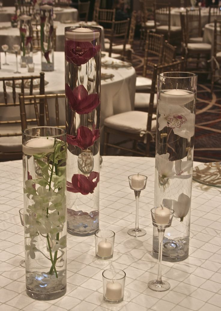 Submersed cymbidium orchids four seasons hotel baltimore for How to make flowers float in vases