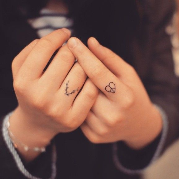 Peace sign fingers tattoo