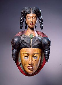 """Anang Ibibio, Nigeria C 20  - From the watery Delta region of eastern Nigeria, this mask was probably made to celebrate the power of Mami Wata (Pidgin English for """"Mother of Water""""). Devotion to Mami Wata takes different forms in different places. Some of her common appearancess are as a mermaid, a woman with a snake around her shoulders, a Hindu deity, and a Westernized African woman combing her hair and looking at herself in a mirror. She has been portrayed as a destructive seductress or…"""
