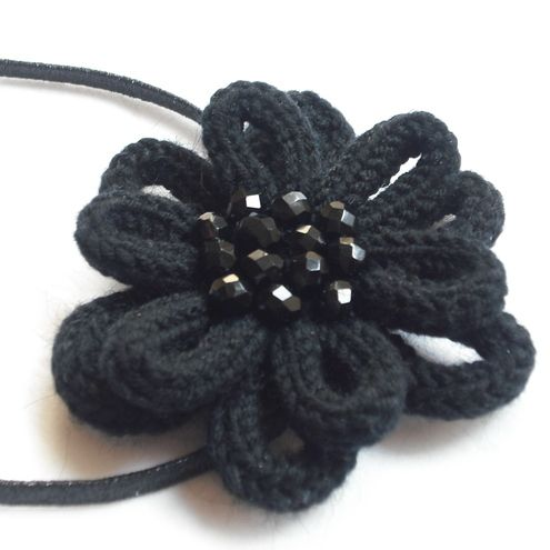 Black flower - this one is knit but I think you could create a crochet cord, form a loop, sew in the center, repeat for the other 5 loops. Repeat for a second layer with larger loops. Finish off. Add a bundle of beads to the center.