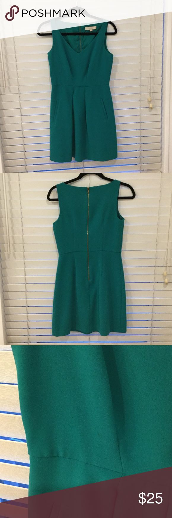 Ann Taylor LOFT green work dress Ann Taylor LOFT dress in a beautiful green color. Has pockets!! I love this dress, just have no use for it anymore. There is a tiny tiny stain as shown in the third picture, not noticeable when worn but happy to post more pictures if you are worried about it! LOFT Dresses