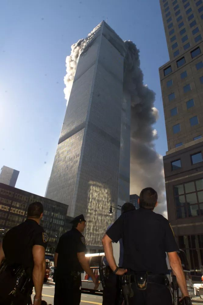 Smoke fumes from the burning twin towers of the World Trade Center after hijacked planes crashed into them on September 11, 2001 in New York City.(AP Photo/Richard Drew)                                                                                                                                                                                 More