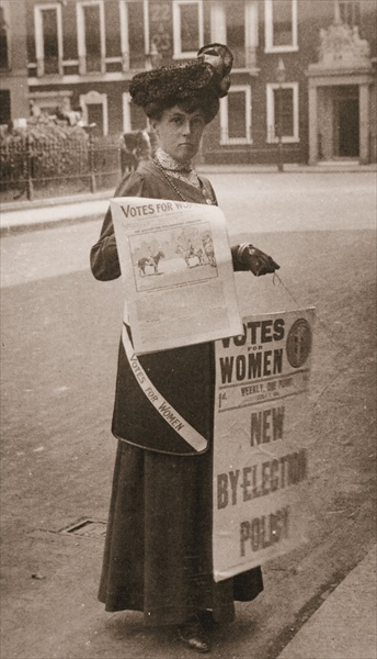 Miss Kelly, a suffragette, selling 'Votes for Women', July 1911