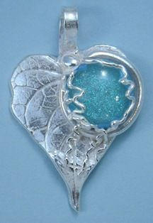 """Beautiful """"stones"""" made by fusing in small amount of your pet's ashes into glass.  What a sweet way to always have your beloved pet with you."""