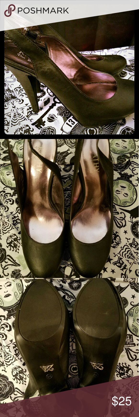 """Kathy Van Zeeland Black Slingback Shoes Kathy Van Zeeland Black Slingback Shoes with Round Toe. 1"""" Platform with 5"""" Heel. Worn once but look brand new. Comfortable for height. Silver KVZ detail on bottom & pink shimmer insole. Kathy Van Zeeland Shoes Heels"""