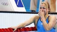 This is what makes the Olympics great.  Lithuania's Ruta Meilutyte reacts after placing first in heat 4 of the women's 100m breaststroke heats during the London 2012 Olympic Games at the Aquatics Centre