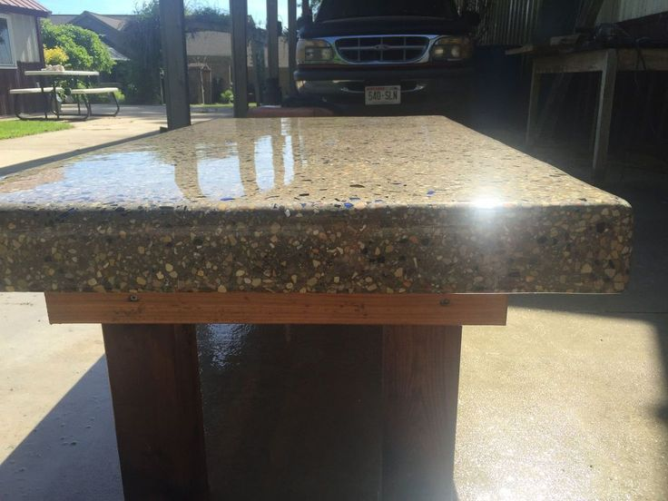diy back yard coffee table top made of concrete with crushed wine bottles bottle coffee. Black Bedroom Furniture Sets. Home Design Ideas