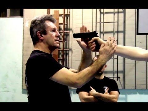KRAV MAGA TRAINING • the fastest gun disarm - YouTube | Mada Krav Maga in Shelby Township, MI teaches realistic hand to hand combat that uses the quickest methods to attack the weakest and most vital targets of both armed and unarmed assailants! Visit our website www.madakravmaga.com or call (586) 745-1171 for more details!