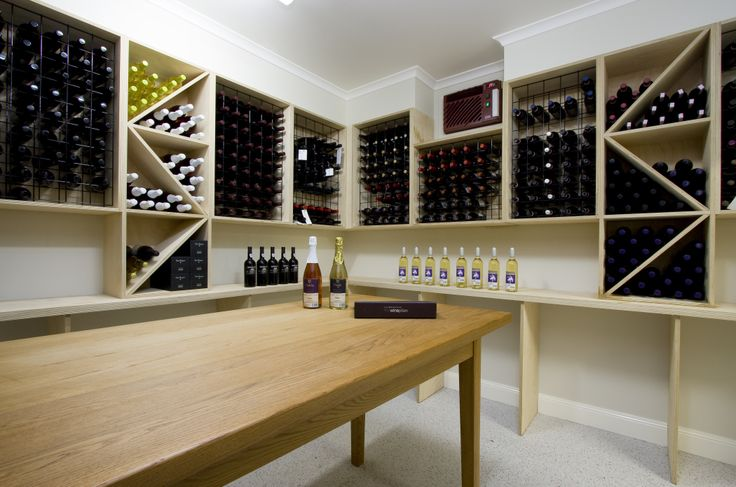 """With access to a significant wine collection it was thought that a purpose built facility would be ideal. Since acreage properties often require storage of additional machinery and vehicles a separate """"shed"""" was incorporated into the design of the property. If features a fully professionally insulated and climate controlled cellar, a storage area, and another space for 2 cars."""
