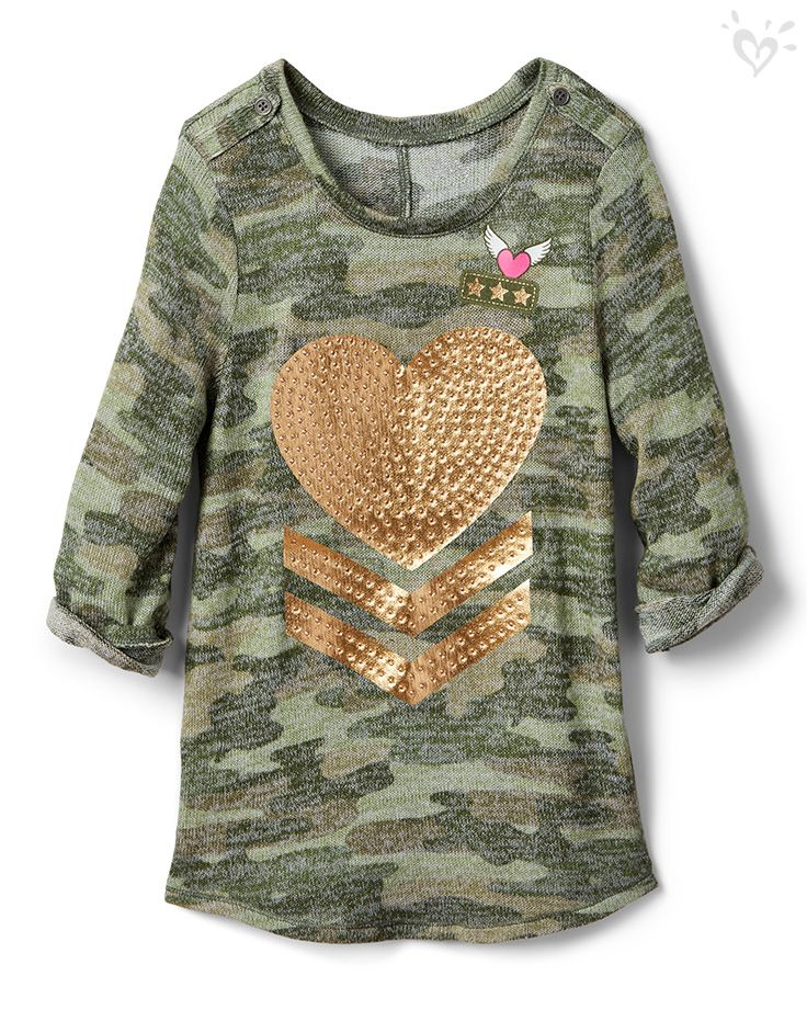 Metallic graphics make our special knit tops shine with extra style!
