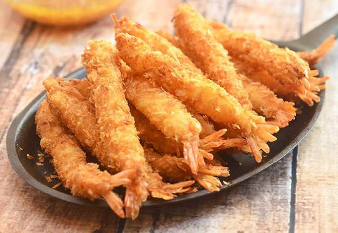 Coconut shrimp are made of large shrimps coated in shredded coconut and Panko bread crumbs, and then deep-fried until golden and crisp