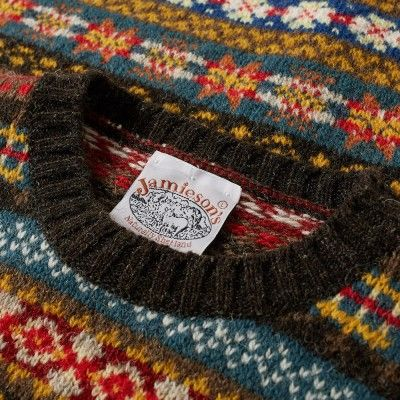 Established in the early 1890's, family owned business Jamieson's have been knitting jumpers in the wilderness of the Shetland Islands for over 120years. Their legacy in producing quality local fabrics still carries on today, this crew neck knit showcases their history and craftsmanship with its brushed wool construction and classic Fair Isle pattern.  100% Pure New Wool Fair Isle Pattern Ribbed Collar, Cuffs and Hem Made in the Shetland Islands, Scotland
