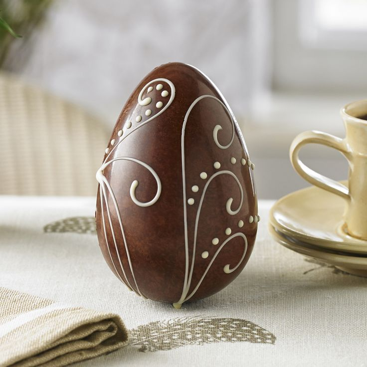 Milk Chocolate Woodland Fern Egg | £5.50 | A Swiss Grand Cru milk chocolate egg with an elegant hand-piped white chocolate woodland fern design and stippled with dark chocolate.