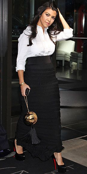 MAXI SKIRTS AND BUTTON-DOWNS    Kourtney Kardashian shows off another way to wear maxis, inspiring us to wear them even when temps drop. A crisp white button-down is all that's needed to take the look from relaxed to rich.
