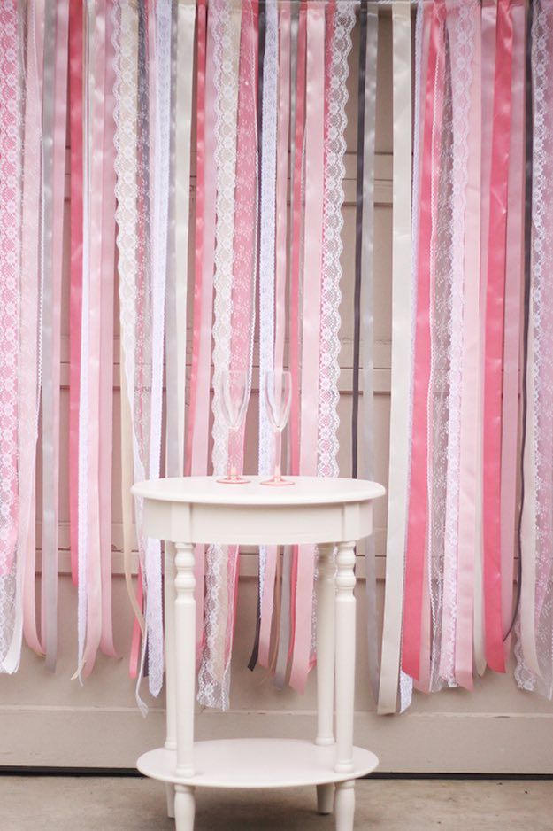 Ribbon And Lace Backdrop | These DIY photo booth ideas will make your next party way more fun! Rally up your family and friends and choose from one of these snapshot-worthy picks!