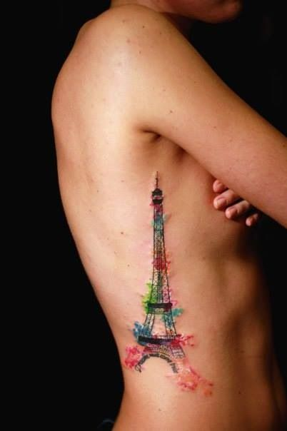 Water color tattoo. Eiffel Tower. Ribcage placement.