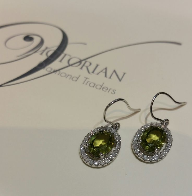 18ct white gold diamond and peridot earrings