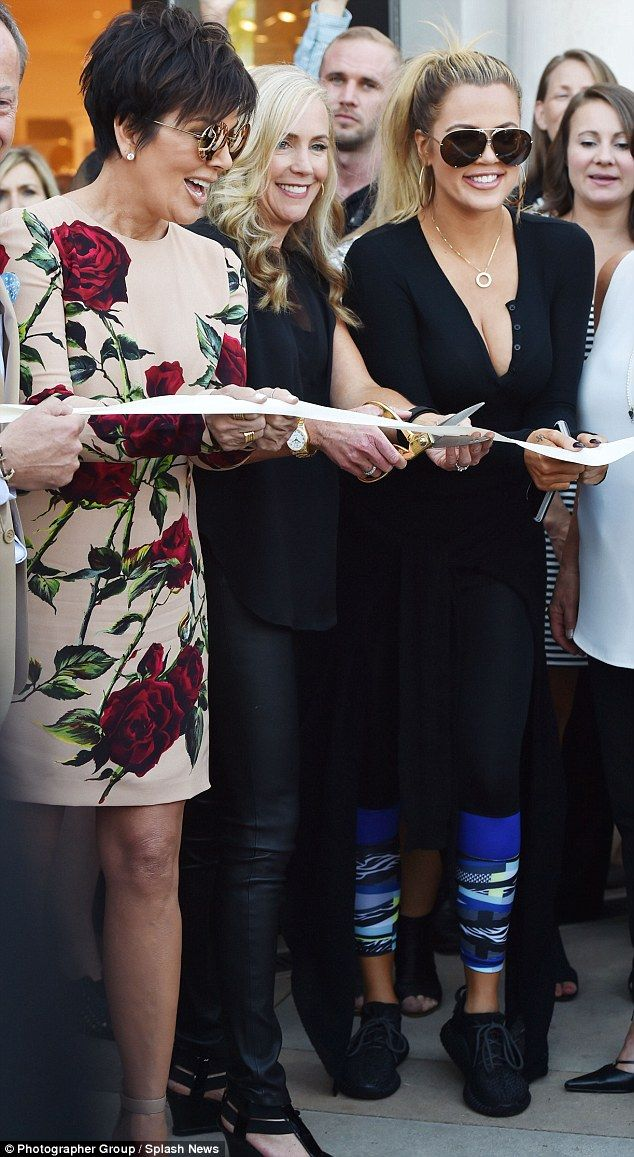 Standing around: Khloe's choice to wear black trainers did not match those around her but may have been more comfortable