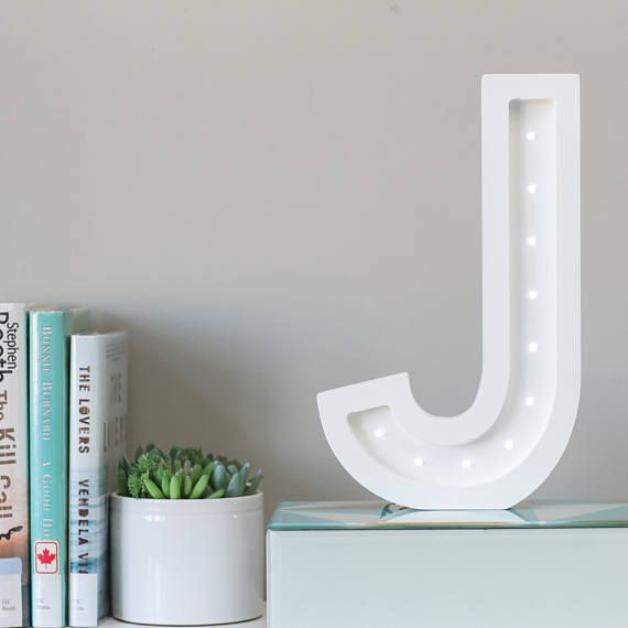 Pulp Function Alphabet Wood Marquees are made to order in any alphabet, symbol or shape you choose. Asides from the electrical components, our marquee signs are made completely out of Canadian wood. We design every piece, have it CNC cut locally in Toronto, and then hand paint and