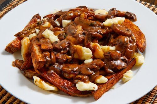Poutine with Mushroom Gravy...courtesy of the Canadian Cuisine. If you haven't had one of these, you've got some making up to do.
