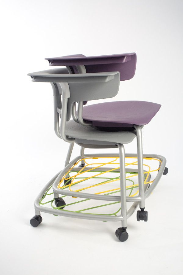 KI's Ruckus stack chair with an optional book rack easily stacks so chairs can be stored when not in use.