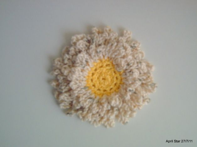 Design CFLYD  Beige layered crochet flower.   Very pretty and versatile.  Attach to a hair clip or band and you've got yourself a lovely hair accessory.  Add a pin and you've created an...