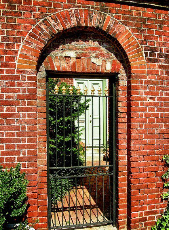 iron gate with brick
