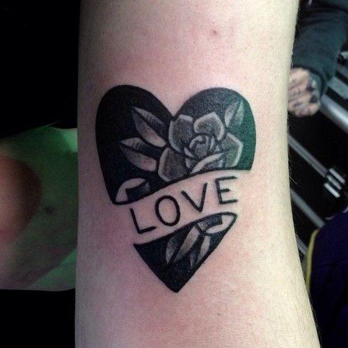 Jaclyn Rehe love tattoo black ink