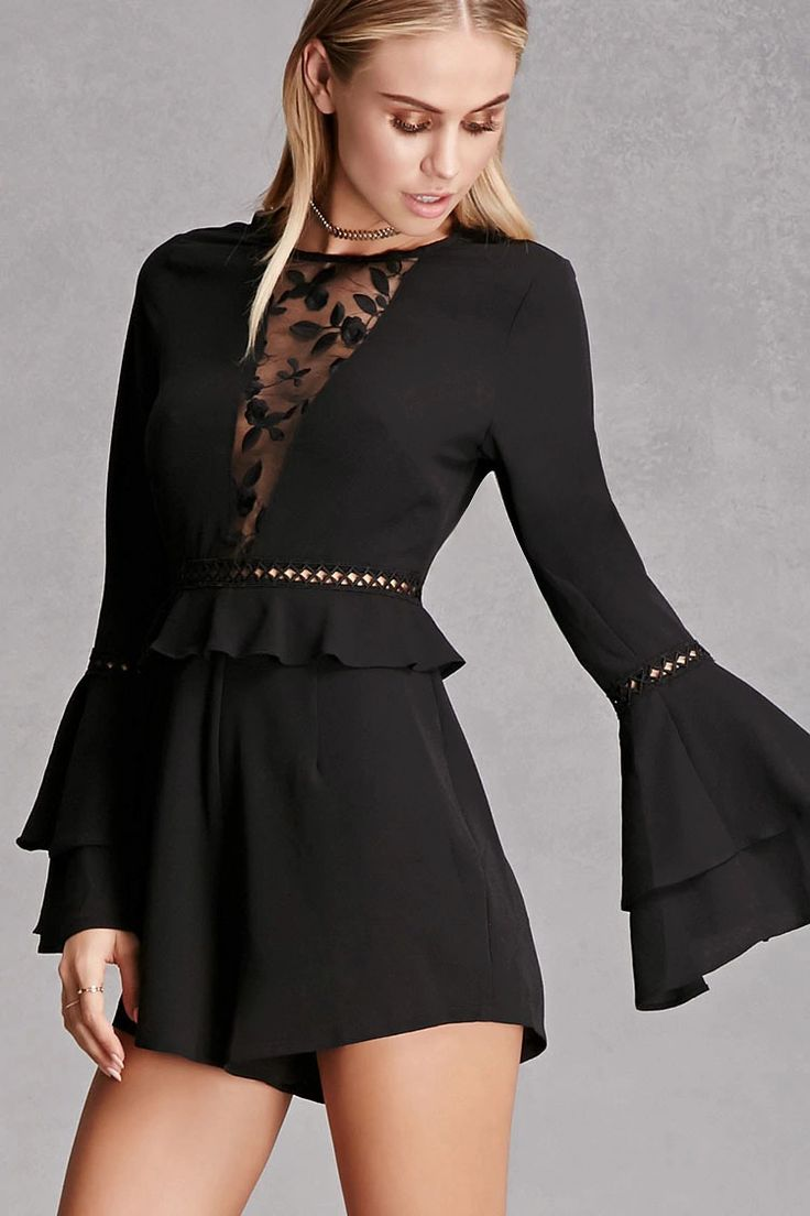 A woven romper by Selfie Leslie™ featuring a flounce detail on along the waist, geo crochet cutout at the waist, long layered trumpet sleeves with a geo crochet cutout arm band, a round neckline with a sheer paneled embroidered floral piece along the center front, and an invisible back zipper.