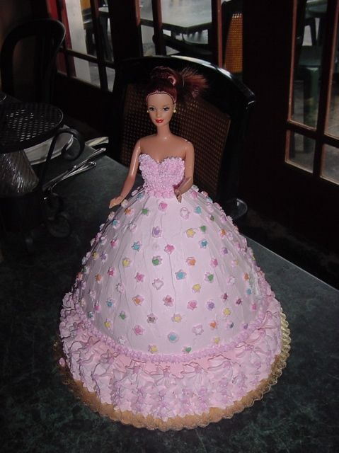 Barbie doll cake - real Barbie doll in cake, covered in whipped cream