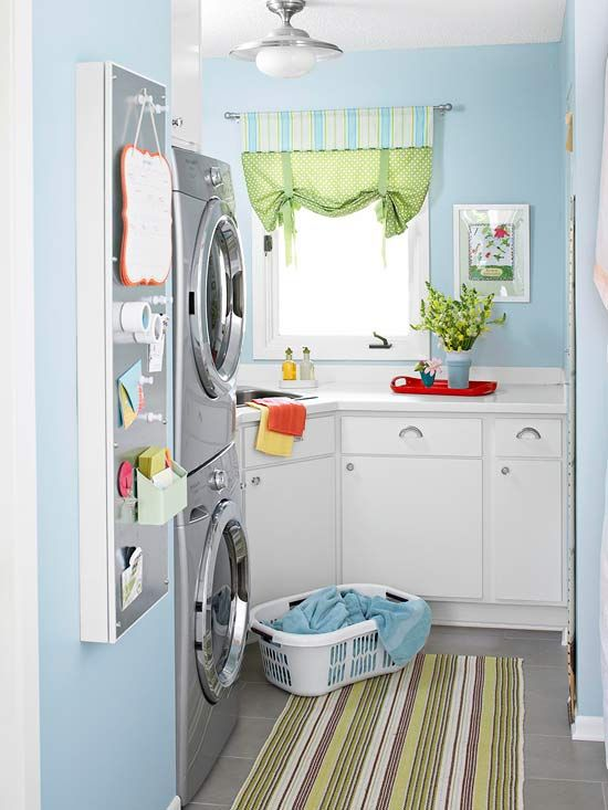 An oddly angled space could have easily been a throwaway, but a unique combination of cabinets helped to turn it into a practical, pretty laundry room. No upper cabinets help to keep the room bright and sunny, while a corner sink-cabinet combo offers essential storage. On a slim pass-through wall, a narrow cabinet pulls out to reveal an ironing board; closed, it's the home's message center.