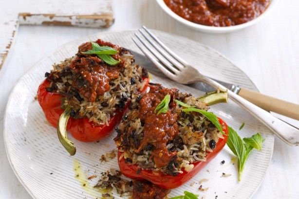 These Middle Eastern lamb & rice stuffed capsicums with roasted garlic & tomato sauce are proudly brought to you by SunRice and taste.com.au.