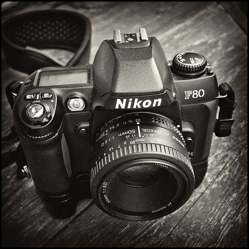 Nikon F80 by Gene Wilburn. Remember film? I do and love showing my toddler my old film camera she is fascinated with the dials and lenses.