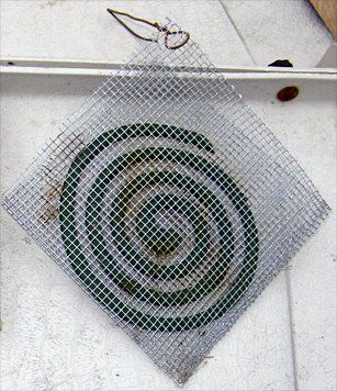 "DIY Mosquito Coil Holder   Purchase a 1'x3' piece of metal screen at your local hardware store. Cut the pieces of screen into units that are 5 inches wide and 12 inches long. Fold in half, bend the screen over itself, thereby creating a holder with two sides open. Gently reshape the metal fold to create a bit of a space or gap between the two sides so that it won't pinch the mosquito coil. Add a loop of cord or an ""S"" shaped piece of wire for hanging.   Brilliant!"