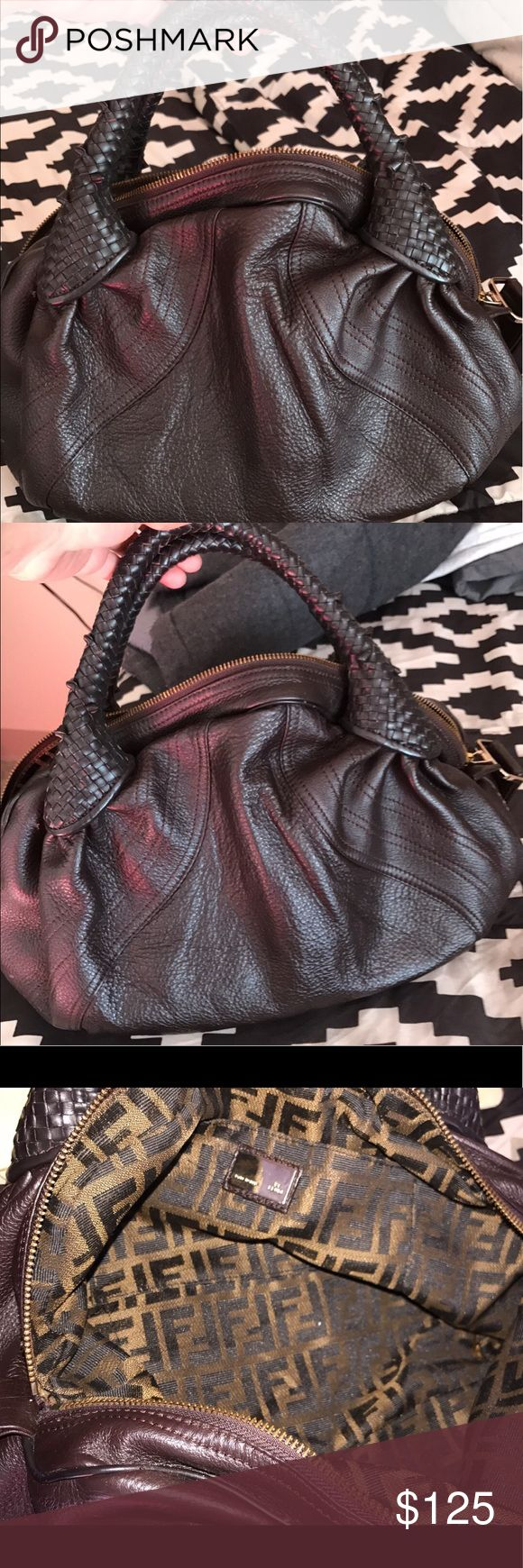 Fendi Mini spy bag Great condition Fendi mini spy bag, I'm the third owner however it had a tear inside and the previous owner got it fixed not noticeable at all inside very clean. The leather on the outside is excellent. Smoke free. Priced to sale Fendi Bags