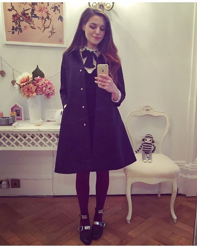 It's raining. Time to wear a super-oversized coat. ☂