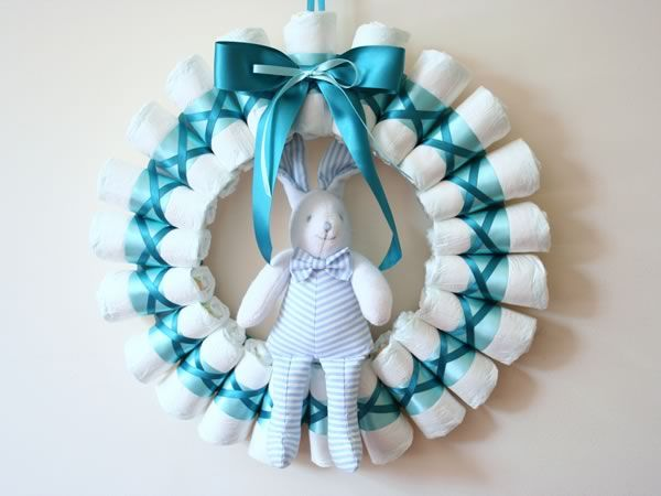 Rolled Diaper Wreath Instructions  Great for a Baby Shower present