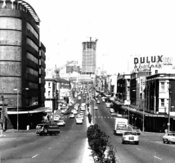 William Street, 1972.  Looking up towards Kings Cross.  The neon sign at the end of the street is missing as the building is under construction.