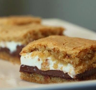 Baked Smores Bars - Cookies, good. S'mores, good. S'mores cookies, GENIUS! The concept is simple, but the results are outstanding! They taste better than smores in my opinion. For those of you who prefer the chewy cookie to the crispy cookie, this is for you..,,