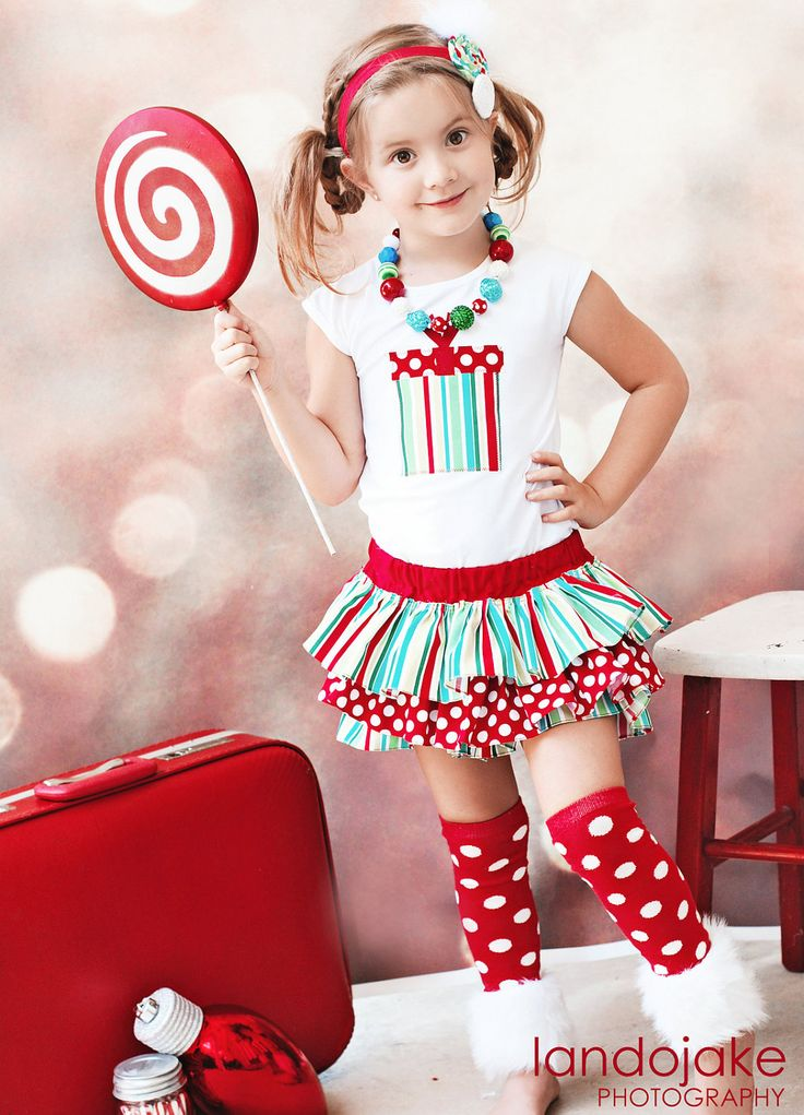 White red and green striped and polka dot Christmas winter all around ruffle bloomers diaper cover skirt tutu for baby newborn infant toddle. $45.00, via Etsy.